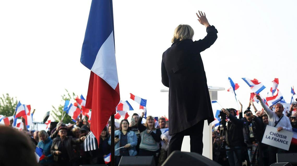 French far-right leader and presidential candidate Marine Le Pen addresses people in Ennemain, northern France, Thursday, May 4, 2017. (AP)