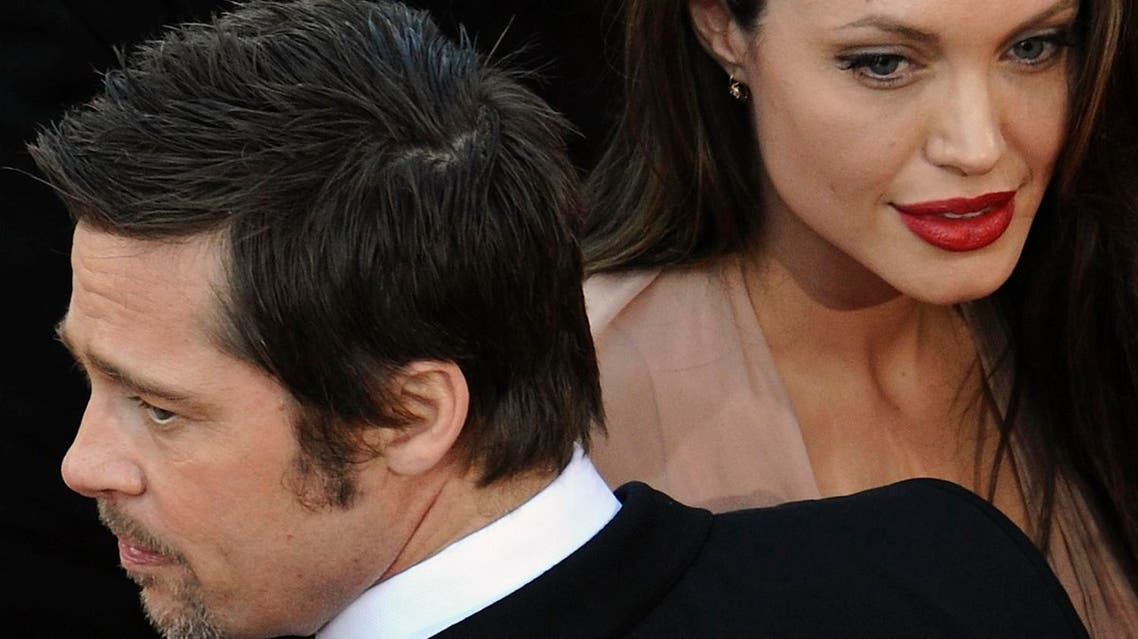 """Cast member Brad Pitt and Angelina Jolie arrive on the red carpet for the screening of the film """"Inglourious Basterds."""" (File photo: Reuters)"""