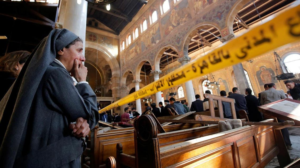 A nun cries as she stands at the scene inside Cairo's Coptic cathedral, following a bombing, in Egypt. (Reuters)