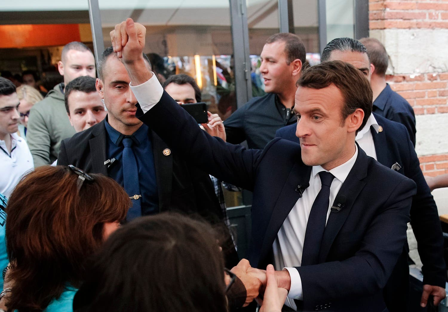 French independent centrist presidential candidate Emmanuel Macron, right, shakes hands with supporters during a campaign rally in Albi, southern France, Thursday, May 4, 2017. (AP)
