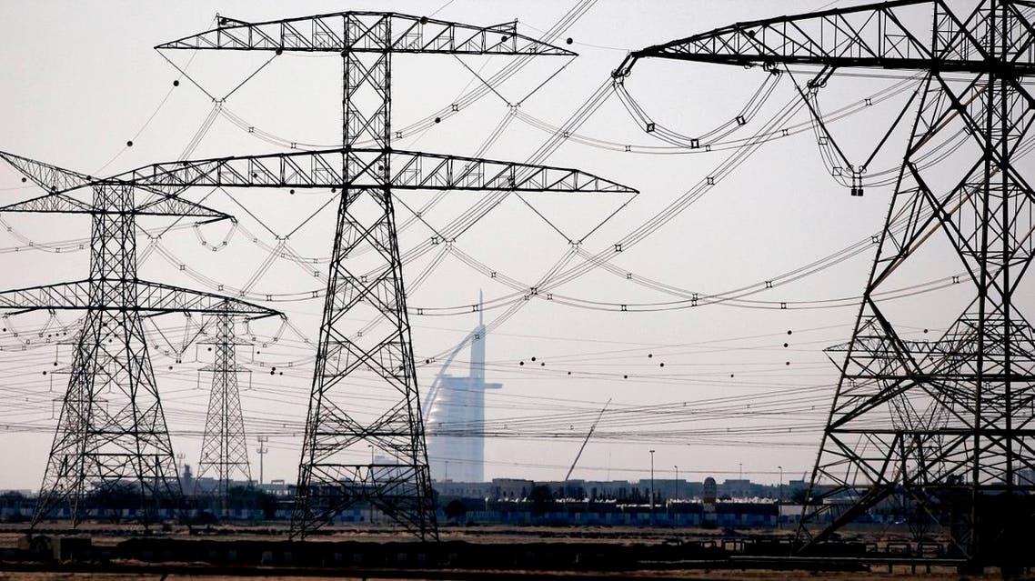 Electric pylons support power cables towards the Al-Qoz area of Dubai. (File photo: Reuters)