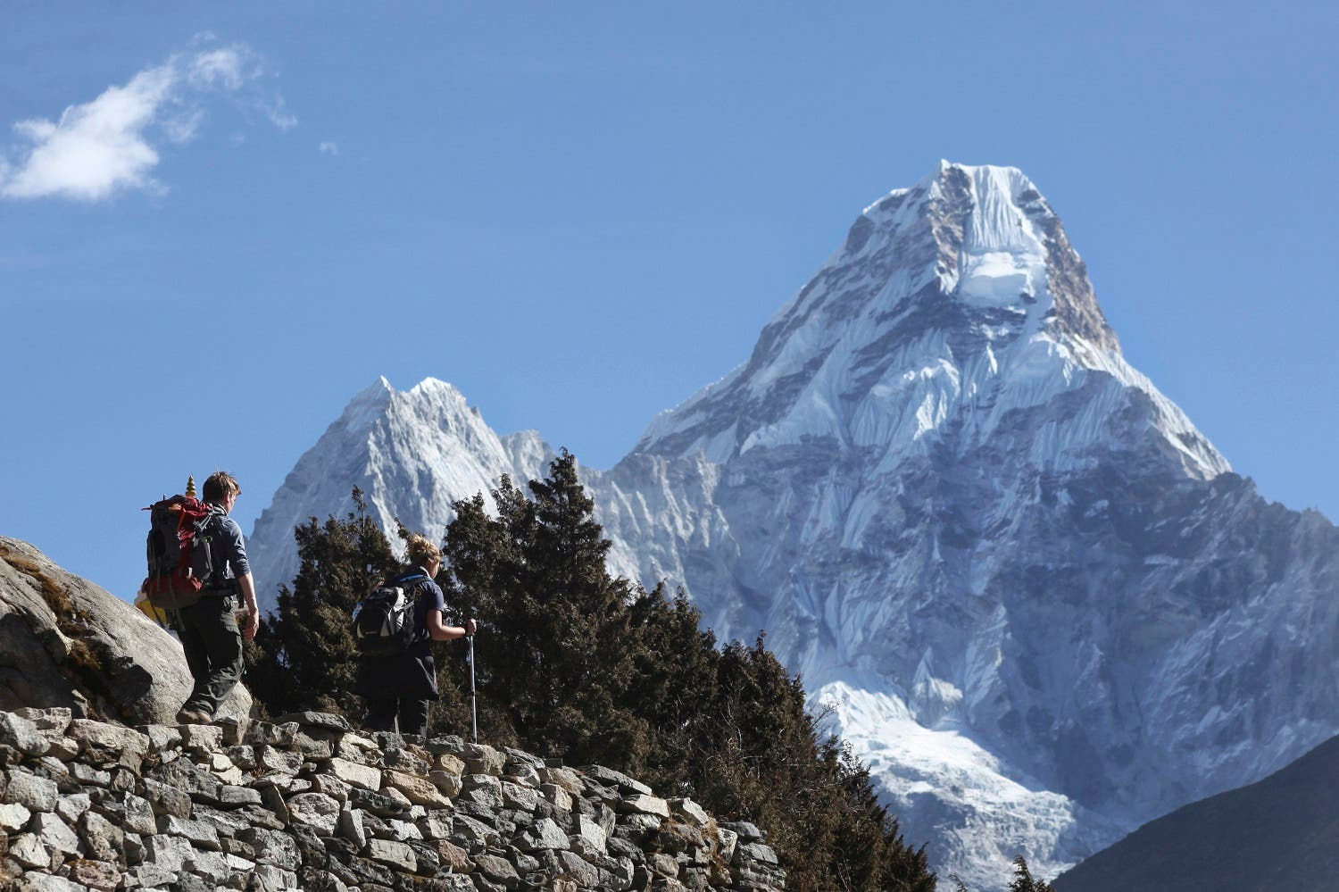In this Feb. 19, 2016, file photo, trekkers make their way to Dingboche, a popular Mount Everest base camp, in Pangboche, Nepal. (AP)