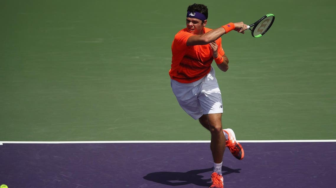 KEY BISCAYNE, FL - MARCH 24: Milos Raonic of Canada in action against Viktor Troicki of Serbia at Crandon Park Tennis Center on March 24, 2017 in Key Biscayne, Florida. Julian Finney/Getty Images/AFP