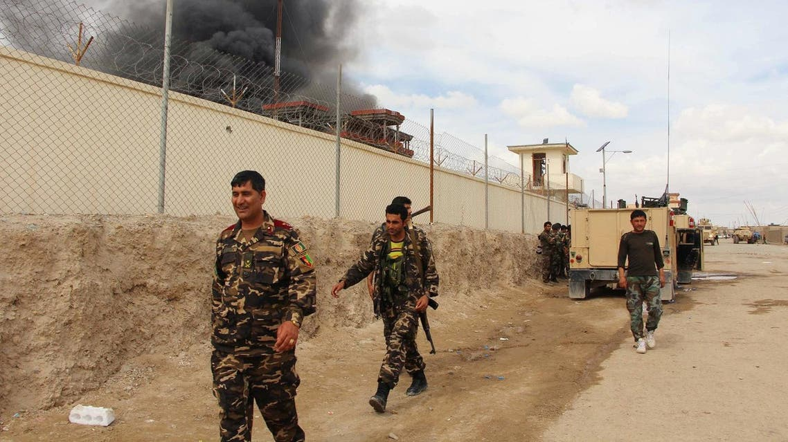 In this March 9, 2016 file photo, smoke rises from a building, where Taliban insurgents hide during a fire fight with Afghan security forces, in Helmand province, Afghanistan. (AP)