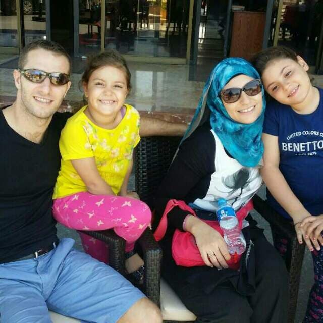 Mahamoud Al Amna with wife Nadine, who is a lawyer by profession, and their daughters Retaj and Taline. The photograph was shot in Cairo nine months ago. (Supplied)