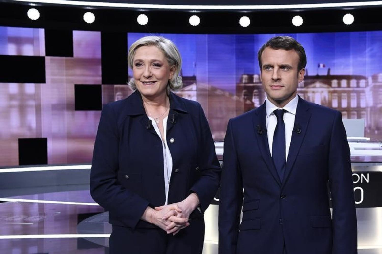 French presidential candidate Emmanuel Macron and far-right candidate Marine Le Pen before the start of a television debate in Paris on May 3, 2017. (Reuters)