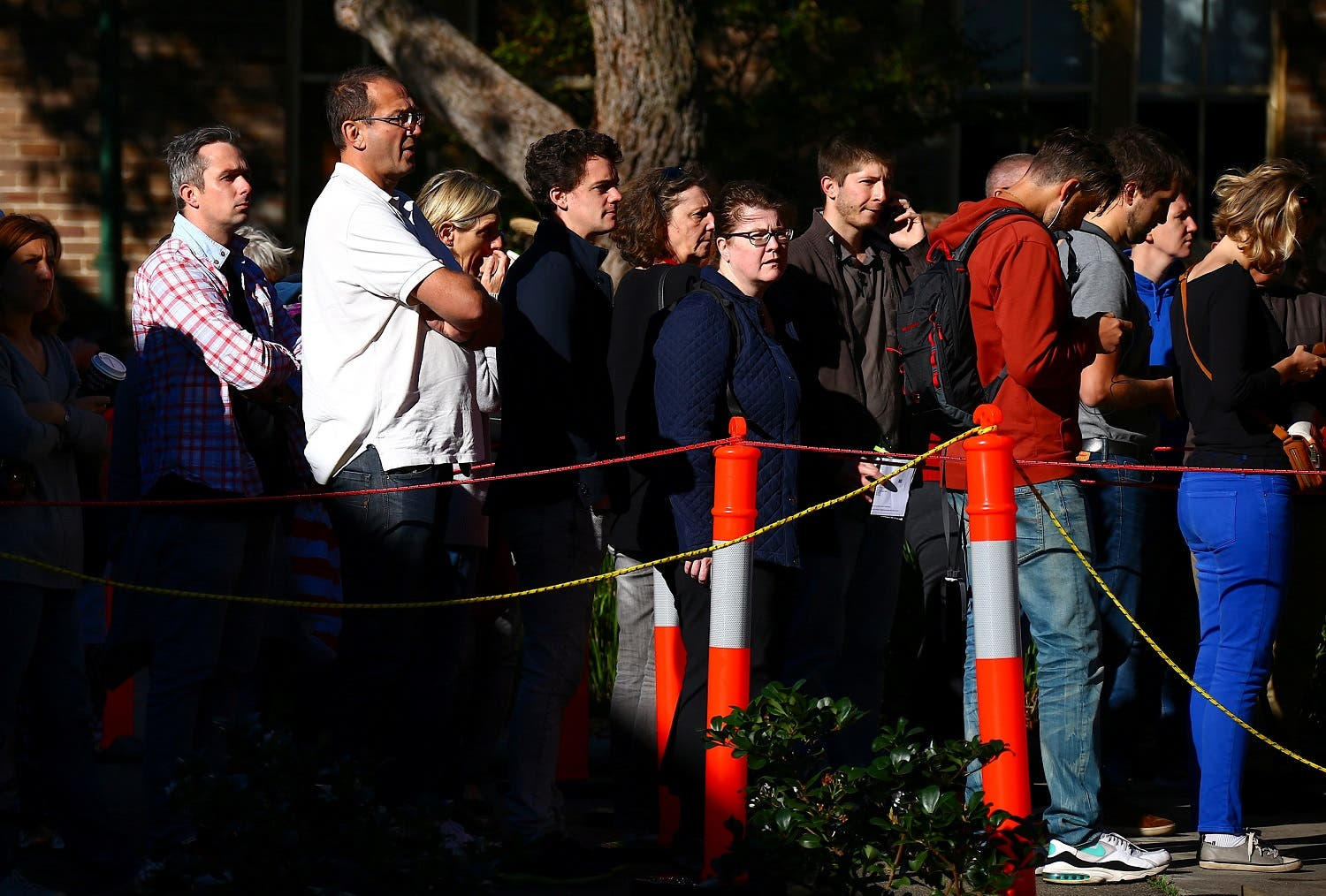 French nationals living in Australia stand in a line as they wait to cast their votes in the presidential poll located at a polling booth located at a school in Sydney, Australia, on May 7, 2017. (Reuters)
