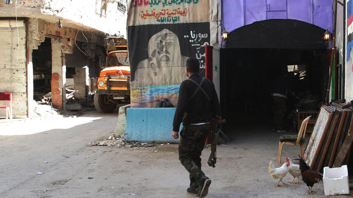 A man walks in a street inside the Yarmuk Palestinian refugee camp in the Syrian capital Damascus on April 6, 2015. Around 2,000 people have been evacuated from the camp after the Islamic State group seized large parts of it. At least 26 people, including civilians as well as fighters from IS and Palestinian factions, had been killed in the camp according to the Syrian Observatory for Human Rights