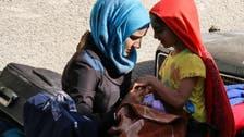 Syrian rebels start leaving Damascus district under evacuation deal