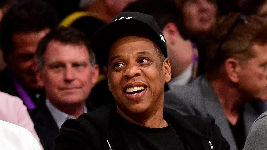 LOS ANGELES, CA - APRIL 13: Jay-Z smiles as he sits courtside as the Los Angeles Lakers take on the Utah Jazz at Staples Center on April 13, 2016 in Los Angeles, California. NOTE TO USER: User expressly acknowledges and agrees that, by downloading and or using this photograph, User is consenting to the terms and conditions of the Getty Images License Agreement. Harry How/Getty Images/AFP