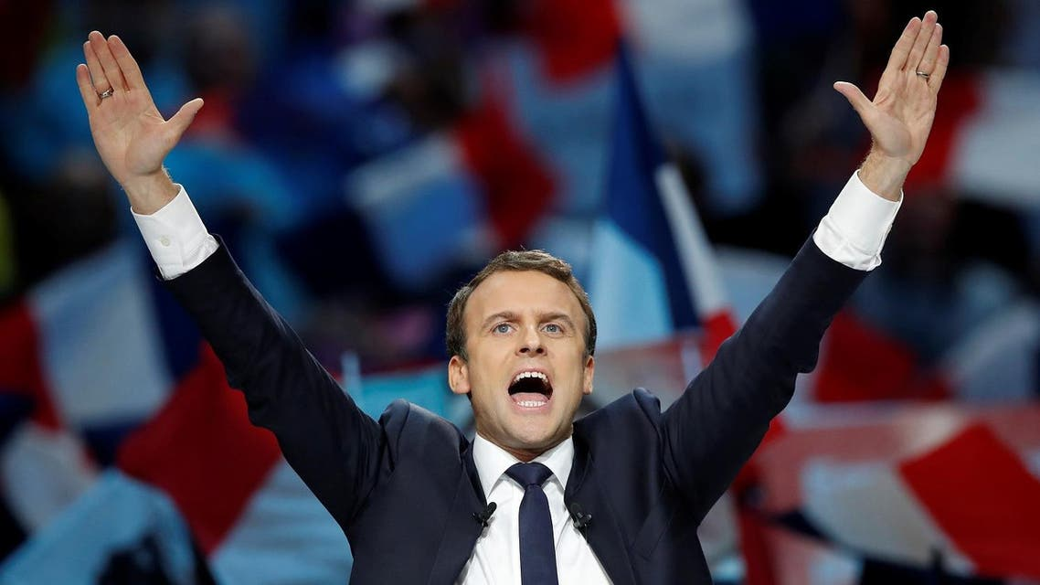 French President-elect Emmanuel Macron celebrates on the stage at his victory rally near the Louvre in Paris, France May 7, 2017. (Reuters)