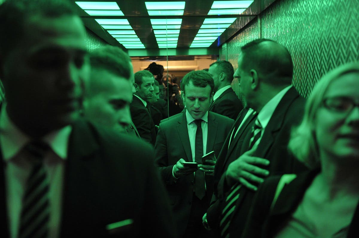 Emmanuel Macron, former French Minister of Economy and candidate in the French presidential elections, departs following a meeting with the French community in Algeria February 13, 2017 in Algiers. (AFP)