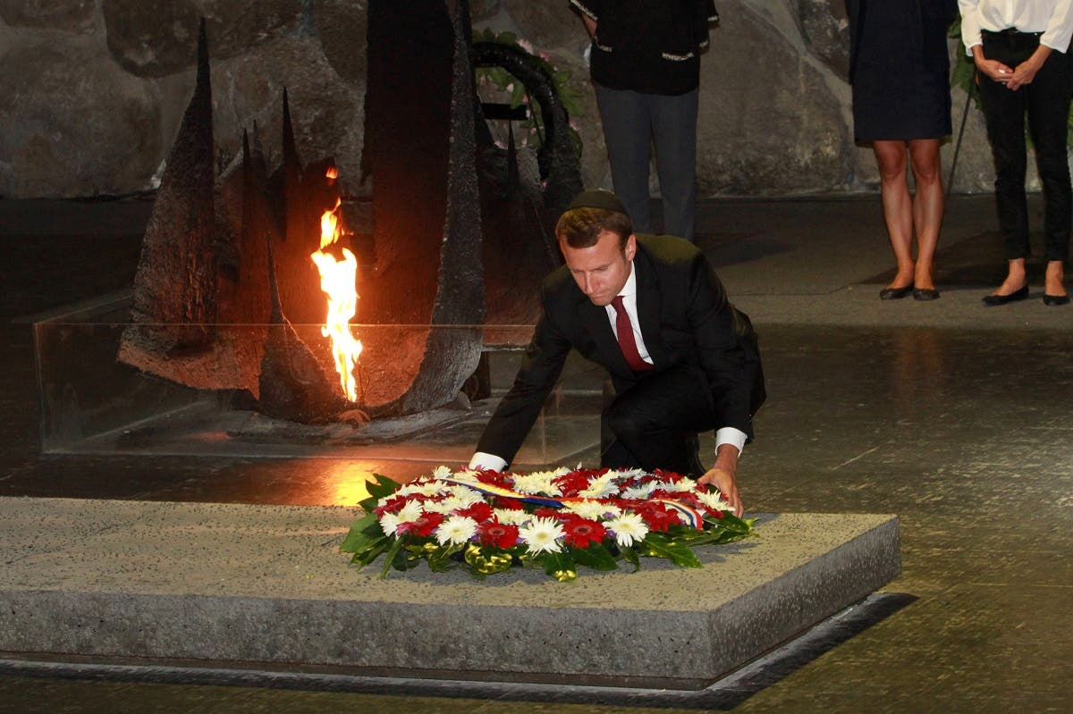 Emmanuel Macron, French Economy and Industry minister at the time, lays a wreath at the Hall of Remembrance as he visits the Yad Vashem Holocaust Memorial museum in Jerusalem. (File photo: AFP)
