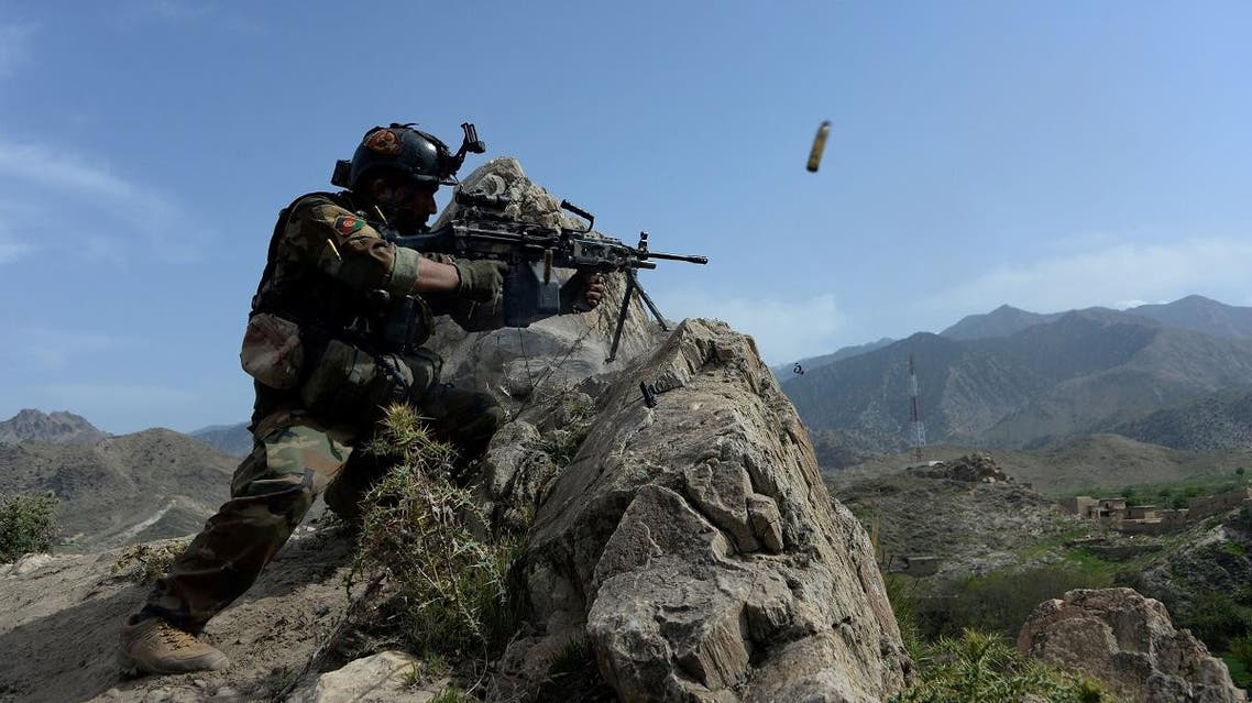 An Afghan security force personnel fires during an ongoing operation against ISIS militants in Nangarhar province. (AFP)