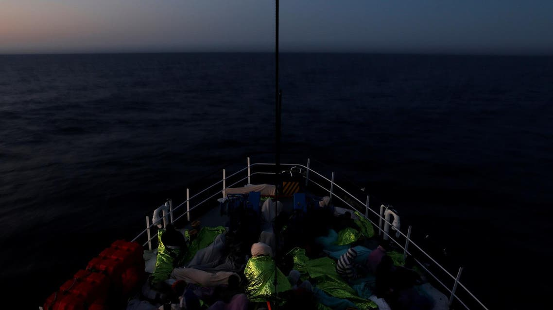 Migrants rest on the Malta-based NGO Migrant Offshore Aid Station (MOAS) ship Phoenix after being rescued in the central Mediterranean off the Libyan coast, as the ship makes its way towards Italy at dusk, April 17, 2017. REUTERS