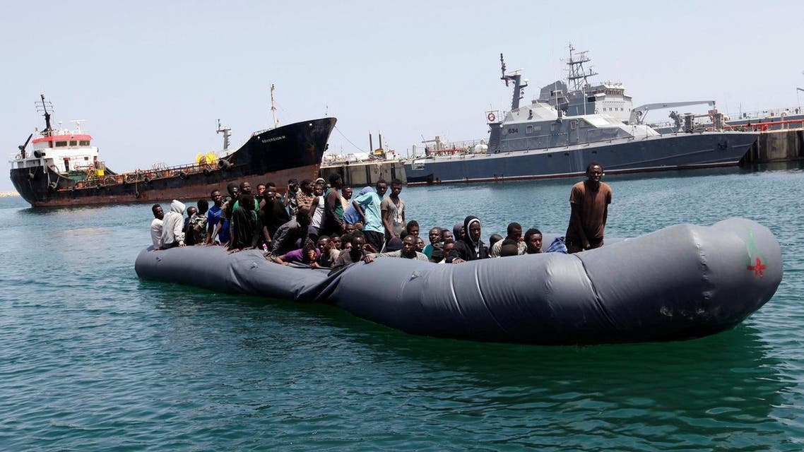 Illegal migrants arrive in a dinghy at a naval base after they were rescued by Libyan coastguard in the coastal city of Tripoli, Libya, May 6, 2017. (Reuters)