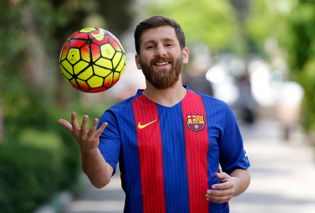 Reza Parastesh, a doppelganger of Barcelona and Argentina's footballer Lionel Messi, poses for a picture in a street in Tehran on May 8, 2017. (AFP)