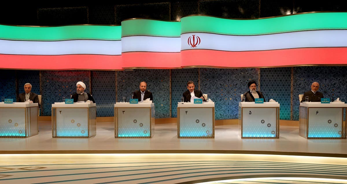 Iranian presidential candidates (L to R) Mostafa Hashemitaba, Hassan Rouhani, Mohammad Baqer Qalibaf, Eshaq Jahangiri, Ebrahim Raisi and Mostafa Mirsalim attend a live debate on state TV in Tehran on April 28, 2017. (AFP)