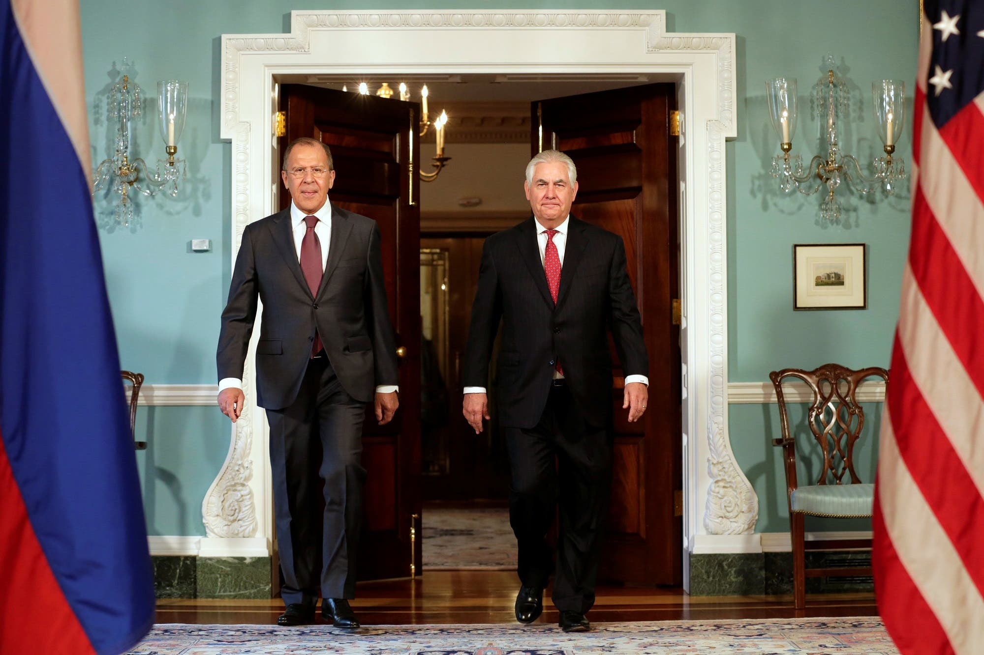 US Secretary of State Rex Tillerson (R) walks with Russian Foreign Minister Sergey Lavrov before their meeting at the State Department in Washington, US. (Reuters)