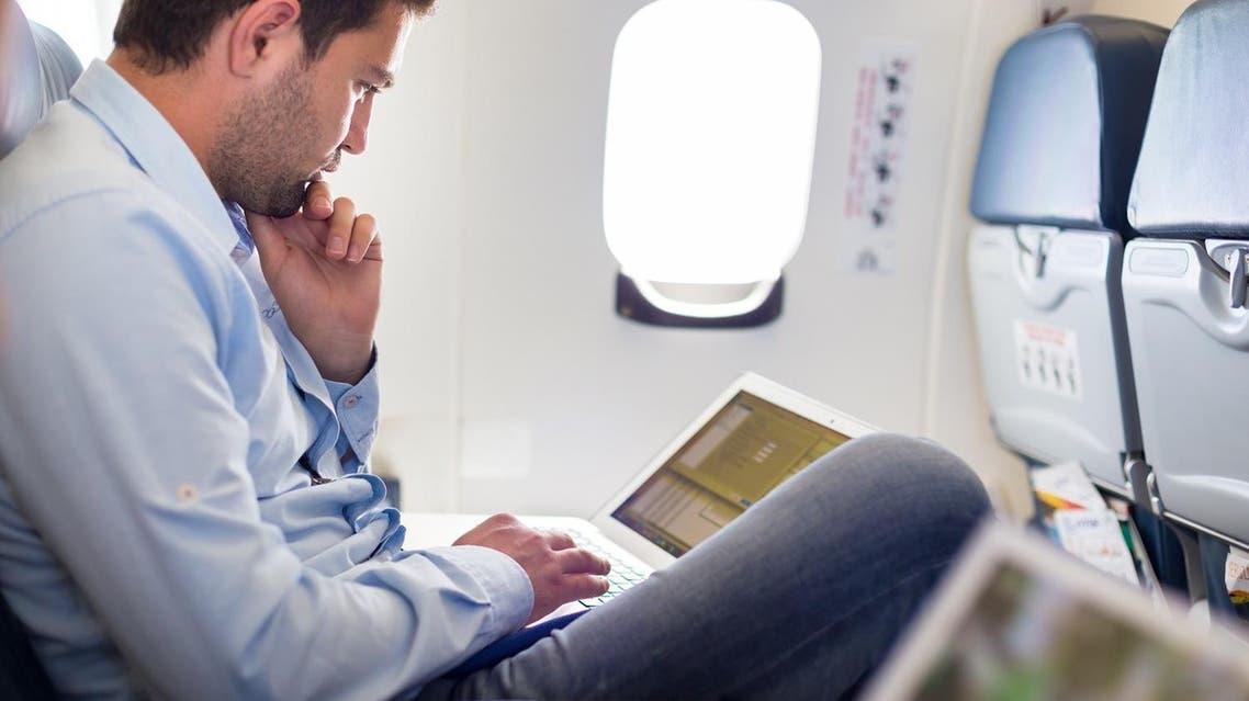 Laptop usage on airplane. (Shutterstock)