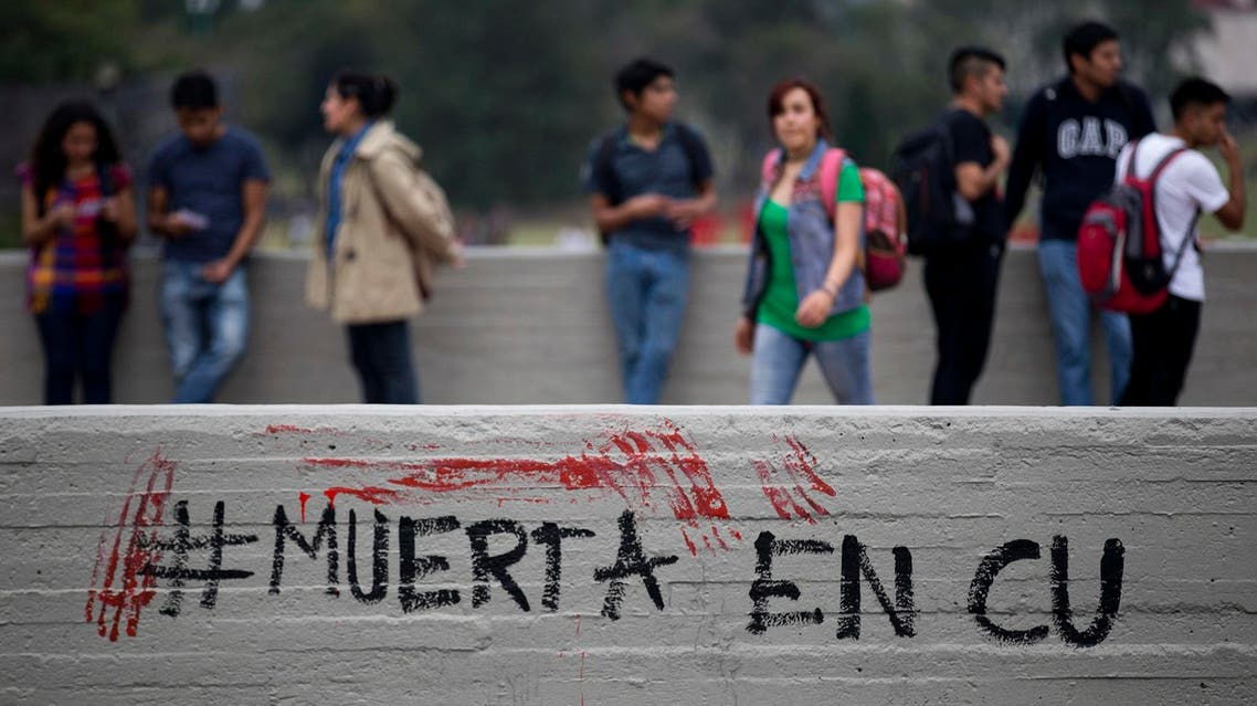 """Words in Spanish spell out a hashtag that means """"Dead in CU,"""" referring to University City, as people protest the death of a young woman on the campus of Mexico's National Autonomous University (UNAM) in Mexico City, Friday, May 5, 2017. The woman's body was found on campus on May 3 tied to a phone booth in the gardens next to UNAM's engineering school, according to a university statement. Her identity and cause of death were not immediately known. (AP Photo/Eduardo Verdugo)"""