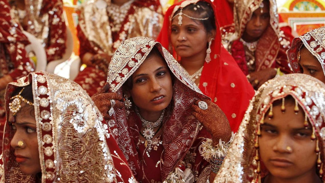 Muslim brides wait for the start of a mass marriage ceremony in Ahmedabad, India, October 11, 2015. A total of 65 Muslim couples from various parts of Ahmedabad. (Reuters)