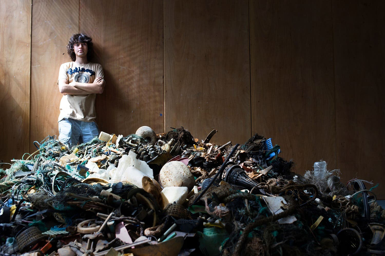 Boyan Slat posing by a pile of garbage found in the sea, in October 2013 in Delft. (AFP)