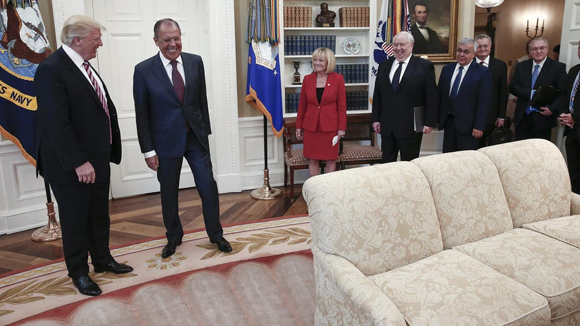 A handout photo made available by the Russian Foreign Ministry on May 10, 2017 shows US President Donald J. Trump (C) speaking with Russian Foreign Minister Sergei Lavrov (L) and Russian Ambassador to the U.S. Sergei Kislyak during a meeting at the White House in Washington, DC. US President Donald Trump on May 10 called on Russia to rein in Syrian President Bashar al-Assad and his key ally Iran, as Washington and Moscow sought to boost their fragile ties with high-profile White House talks. Russian Foreign Minister Sergei Lavrov, the highest-ranking Russian official to visit Washington since Trump came to power in January, earned a rare invitation to the Oval Office for a head-to-head with the Republican president.