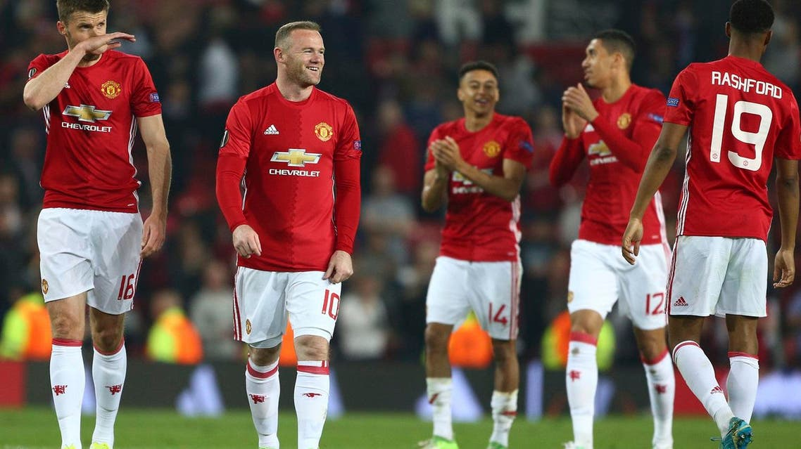 Wayne Rooney celebrates with teammates after the end of the Europa League semifinal second leg soccer match between Manchester United and Celta Vigo at Old Trafford in Manchester on May 11, 2017. (AP)