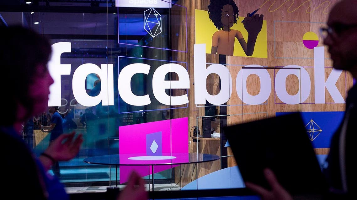 In this April 18, 2017 file photo, conference workers speak in front of a demo booth at Facebook's annual F8 developer conference in San Jose, California. (AP)