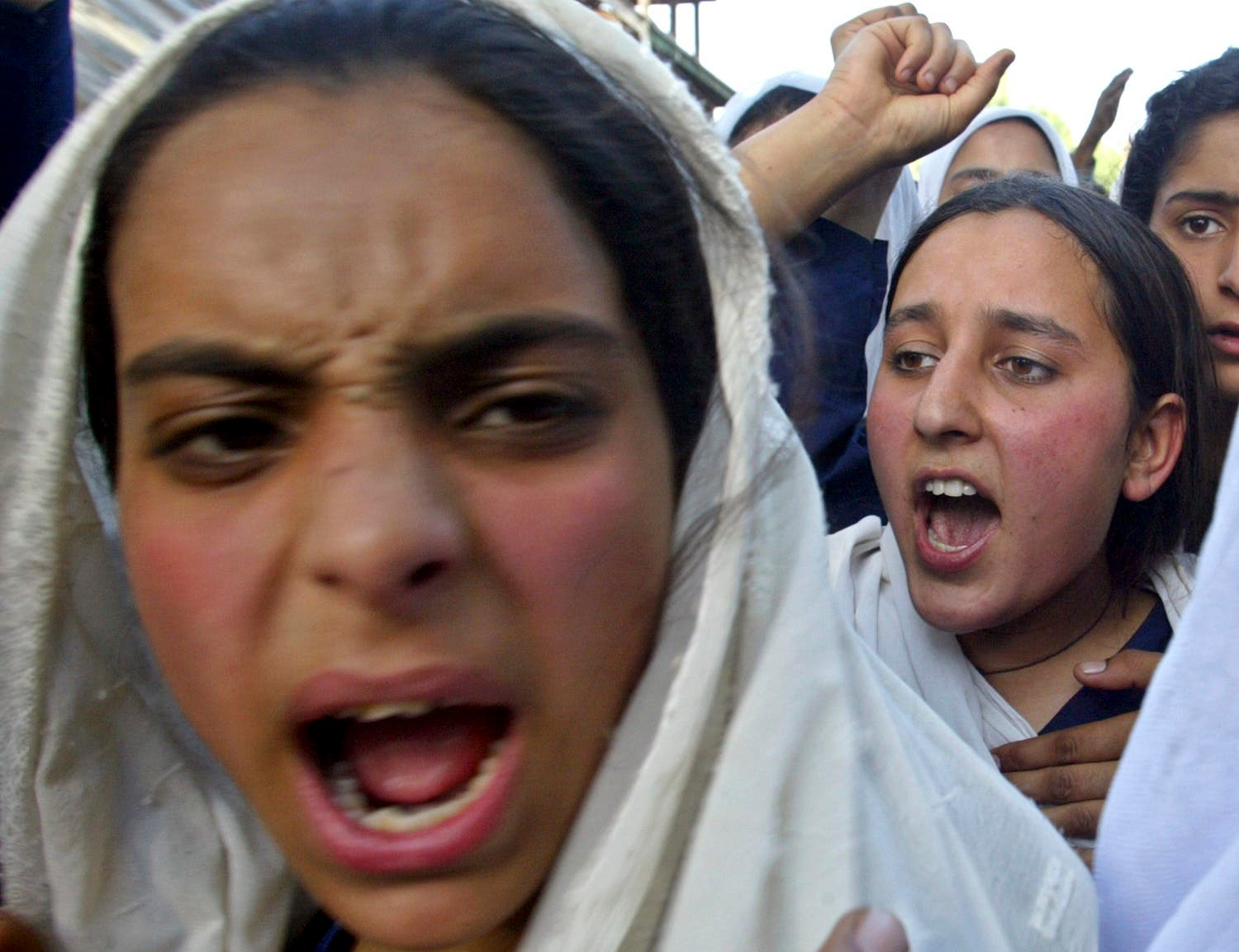 Kashmiri school girls shout slogans against the Indian army during a protest in Pattan, near Srinagar, May 27, 2006. (Reuters)