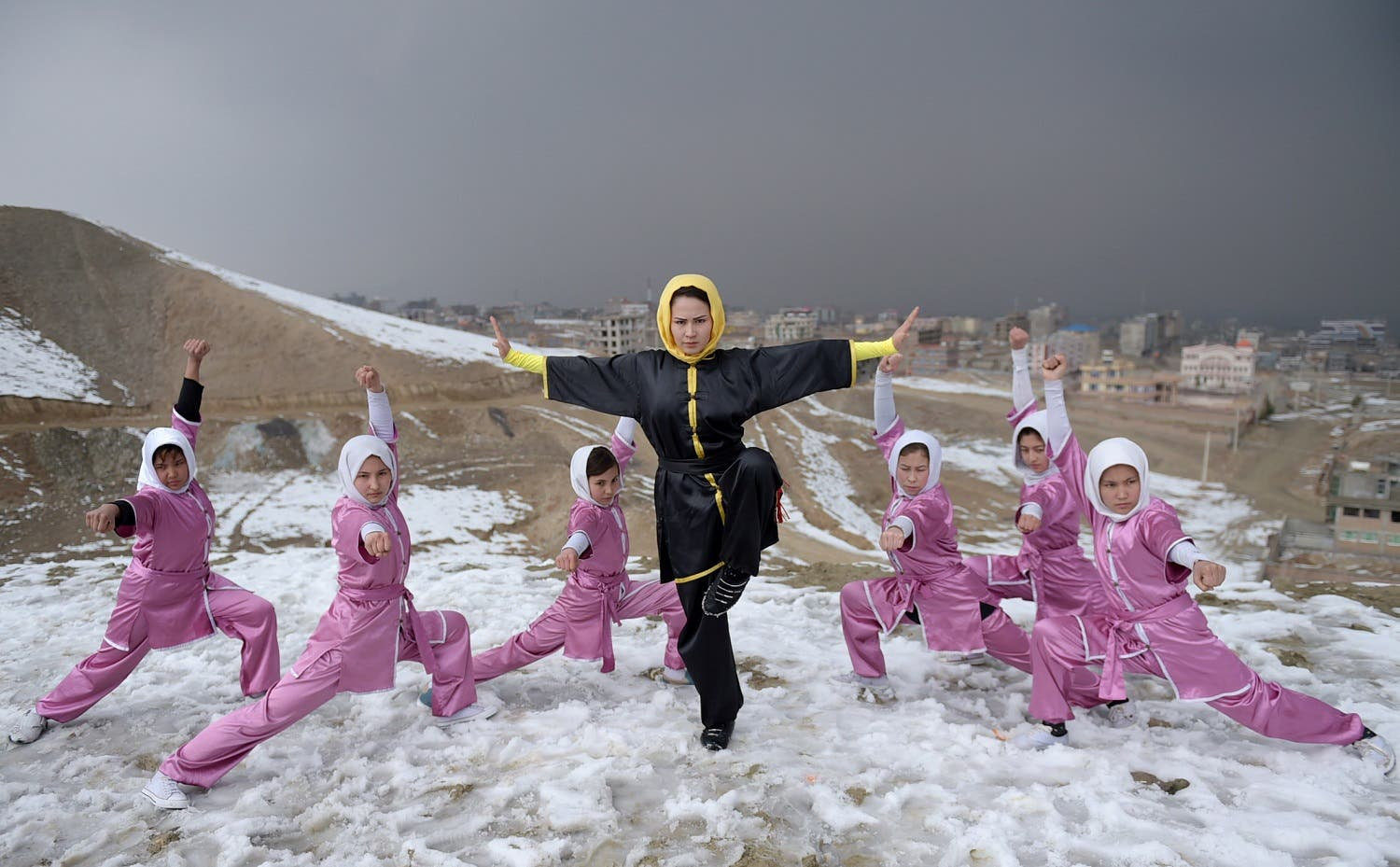 In this photograph taken on January 29, 2017, Afghan members of a wushu martial arts group pose for a photograph at the Shahrak Haji Nabi hilltop overlooking Kabul. (AFP)