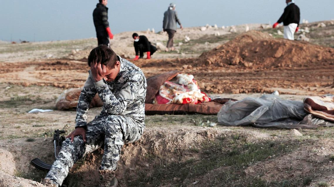 An Iraqi policeman at the burial site for bodies found in a mass grave in an area recently re-taken from ISIS in Hamam al-Alil, Iraq on March 15, 2017. (File photo: AP)