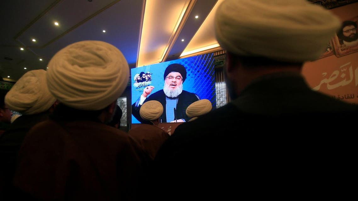 Lebanon's Hezbollah leader Sayyed Hassan Nasrallah addresses his supporters through a screen during a rally commemorating the annual Hezbollah Martyrs' Leaders Day in Jebshit village, southern Lebanon February 16, 2017. (Reuters)