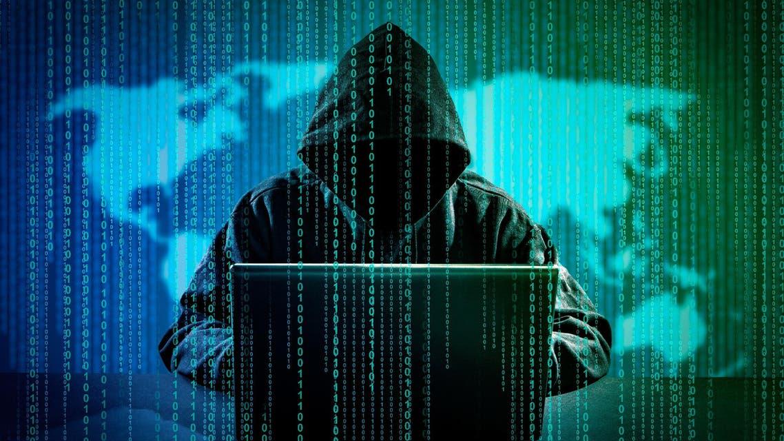 Computer hacker stealing data from a laptop