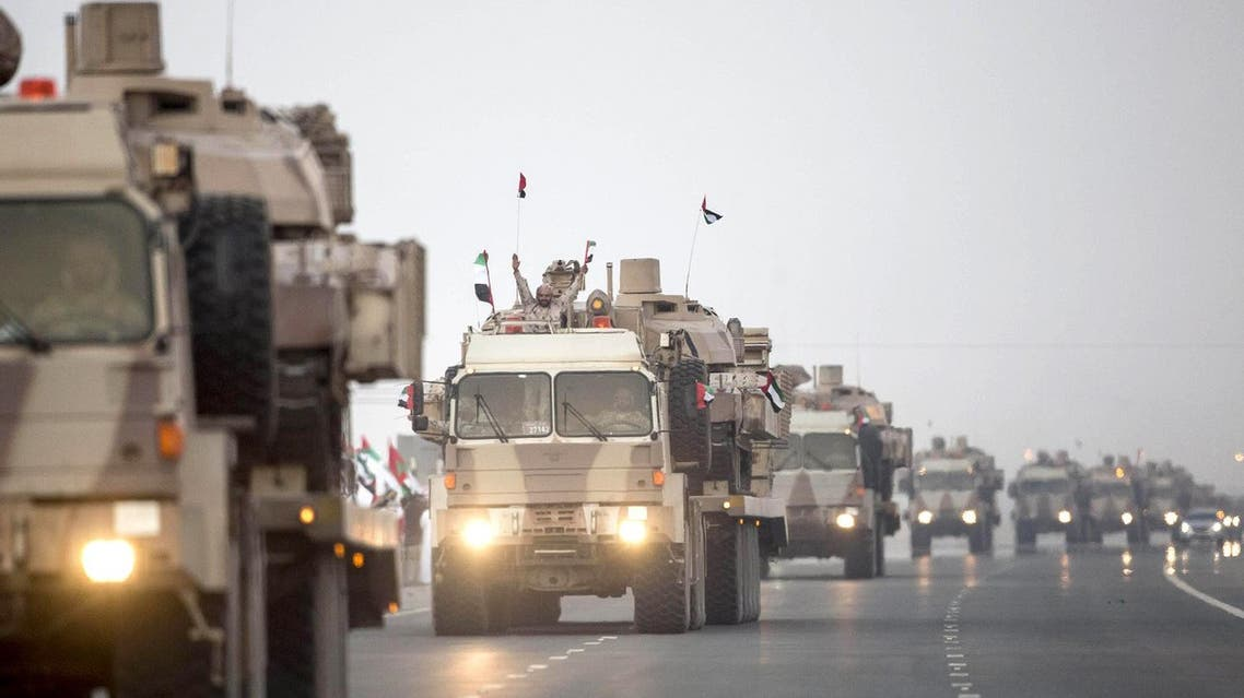 """A handout image made available by United Arab Emirates News Agency (WAM) on November 7, 2015 shows a UAE military convoy traveling from the Al-Hamra military base to Zayed city after returning from Yemen. The UAE has lost 68 soldiers fighting as part of the Arab coalition against Iran-backed rebels in Yemen. AFP PHOTO / HO / WAM === RESTRICTED TO EDITORIAL USE - MANDATORY CREDIT """"AFP PHOTO / HO / WAM"""" - NO MARKETING NO ADVERTISING CAMPAIGNS - DISTRIBUTED AS A SERVICE TO CLIENTS ==="""