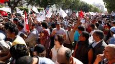 تونسيون يحتجون على قانون للمصالحة مع رموز بن علي