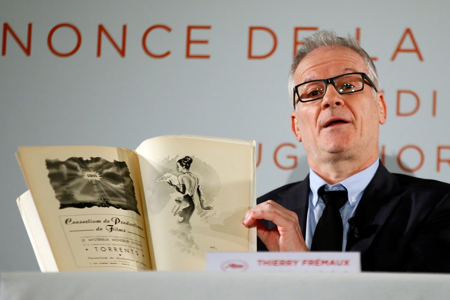 Cannes director Thierry Fremaux displays a 1946th festival book during a press conference for the 70th edition of the festival. (AP)