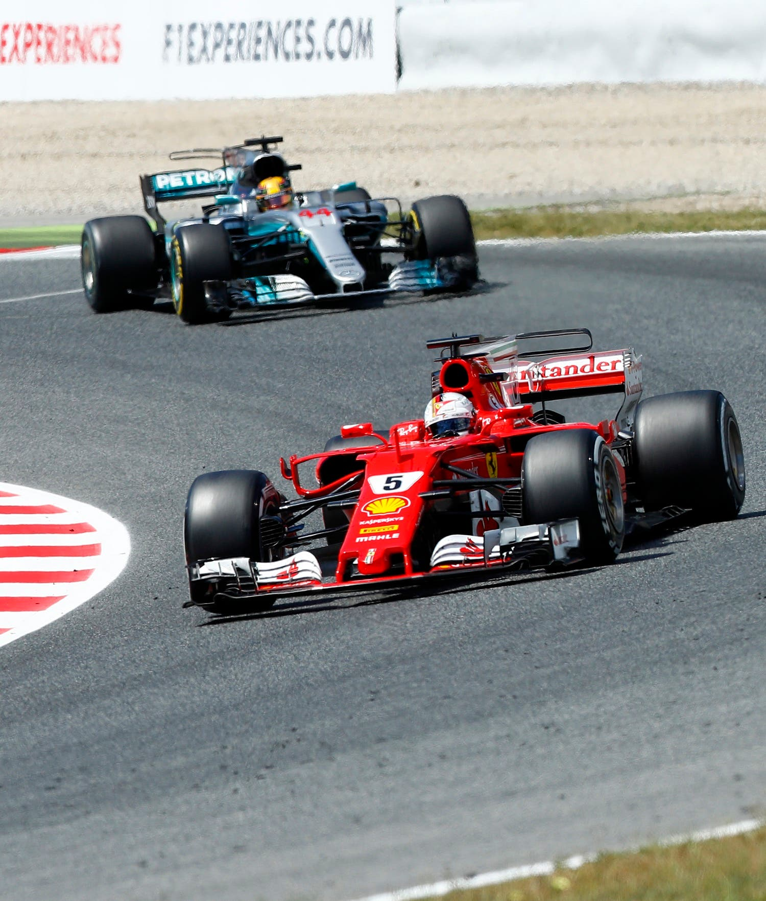 Ferrari's Sebastian Vettel (right), leads Mercedes driver Lewis Hamilton through a corner during the Spanish Formula One Grand Prix. (AP)