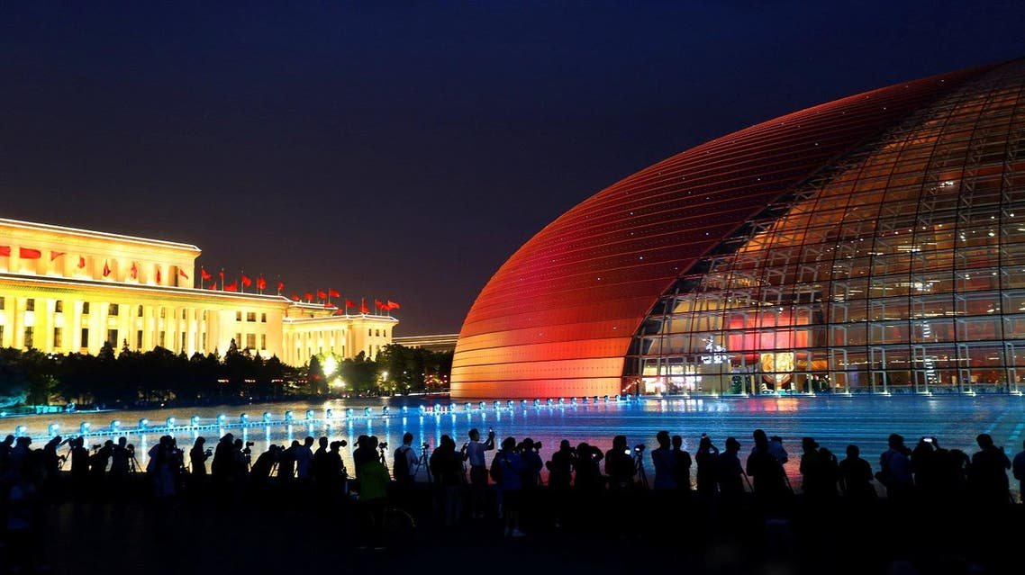 The Grand National Theatre is illuminated ahead of the Belt and Road Forum in Beijing, China, May 12, 2017. (Reuters)