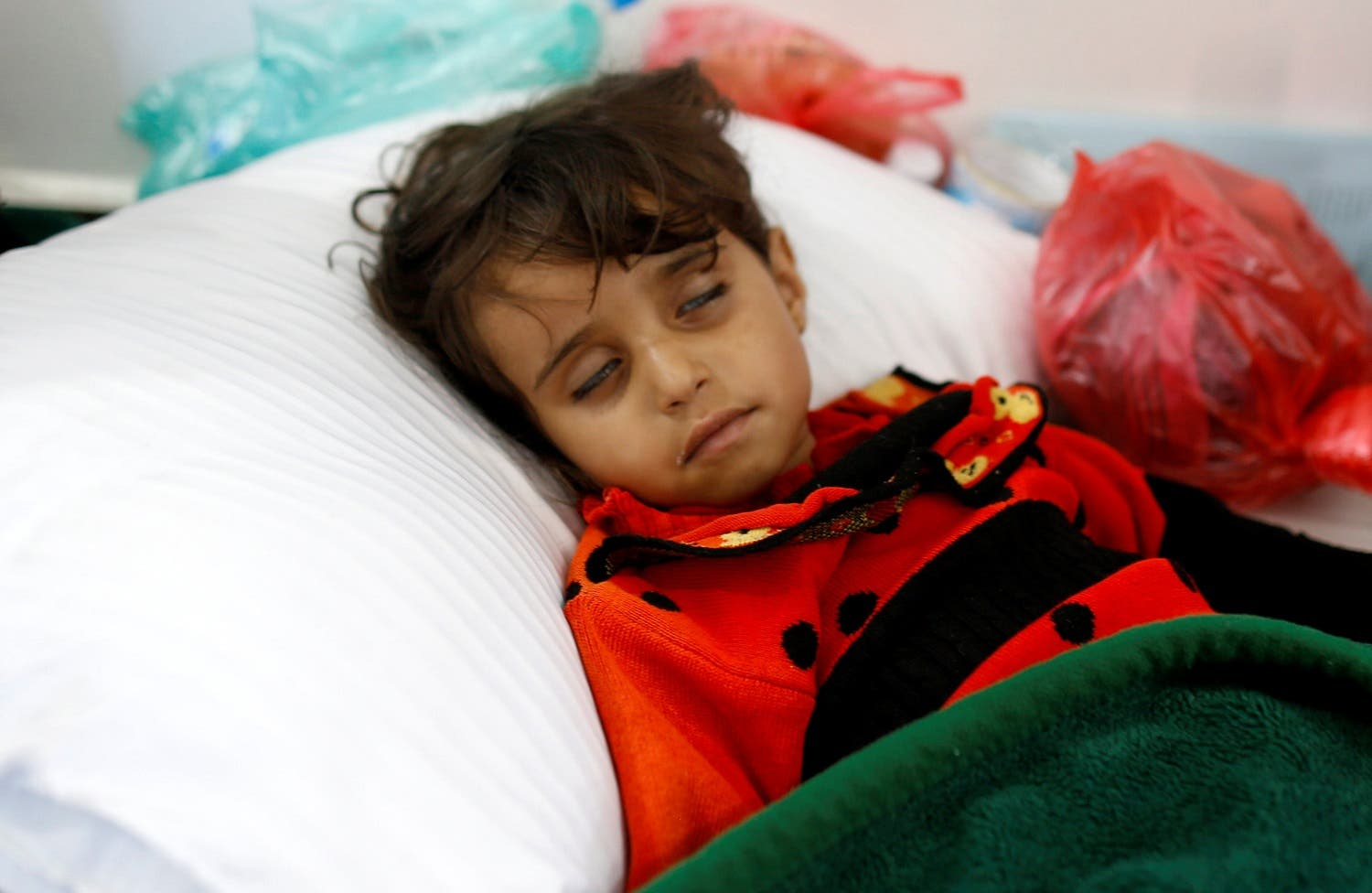 A girl infected with cholera lies on the ground at a hospital in Sanaa, on May 7, 2017. (Reuters)
