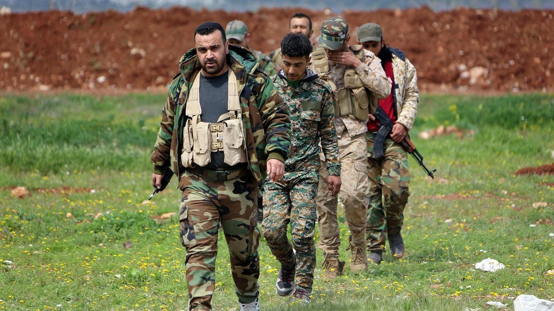 Members of the Syrian government forces march near the town of Qumhanah in the countryside of the central province of Hama, on April 1, 2017. Syrian government forces and allies regained most of the territory they lost earlier during an assault by rebels and jihadists launched on March 21, 2017 in the country's centre, reported the Britain-based Syrian Observatory for Human Rights monitor on March 31, 2017. (AFP)