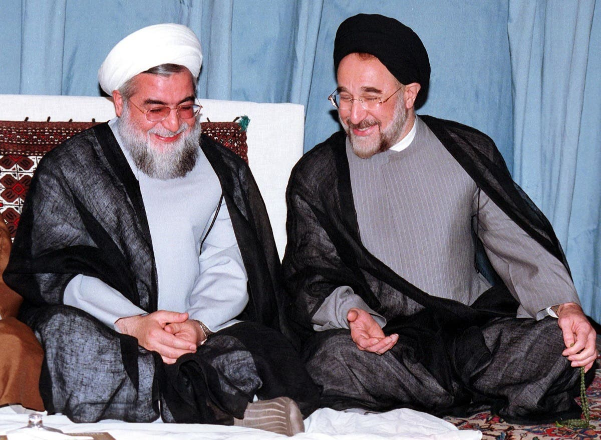 An old photo shows Iranian ex-president Khatami (R) sharing a laugh with Rouhani, who was a former deputy parliament speaker and member of Iran's Council of Experts at the time, in August, 2000 (AFP)