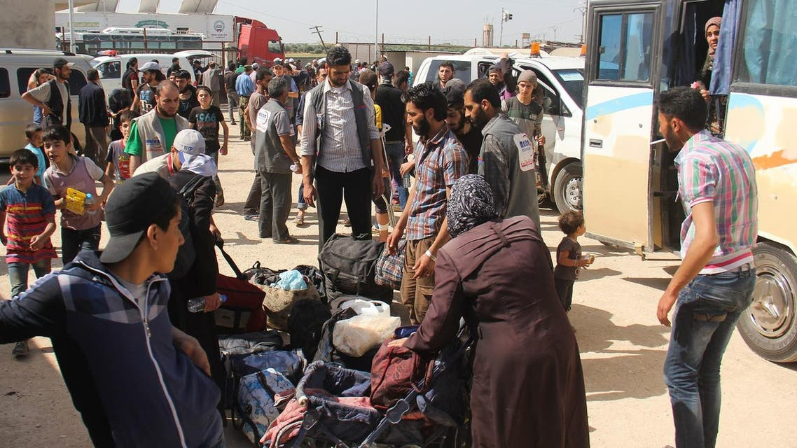 Syrian civilians and rebels, who were evacuated from the Qabun district in northeast Damascus, arrive at a temporary camp in the northern countryside of Idlib province on May 15, 2017. (AFP)