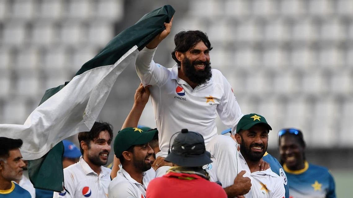 Retiring Pakistan cricket team captain Misbah-ul-Haq is carried by teammates as they celebrate winning the final test match and the series 2-1 against the West Indies. (AFP)