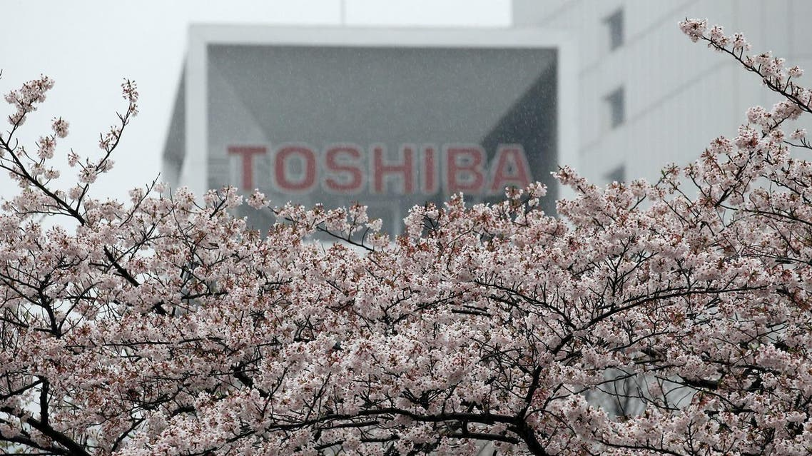DATE IMPORTED: 11 April, 2017 The logo of Toshiba Corp is seen behind cherry blossoms at the company's headquarters in Tokyo, Japan April 11, 2017. (Reuters)