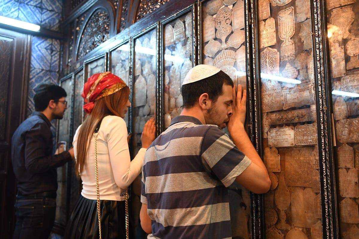 Jewish pilgrims pray at the Ghriba synagogue in the Tunisian resort island of Djerba. (AFP)