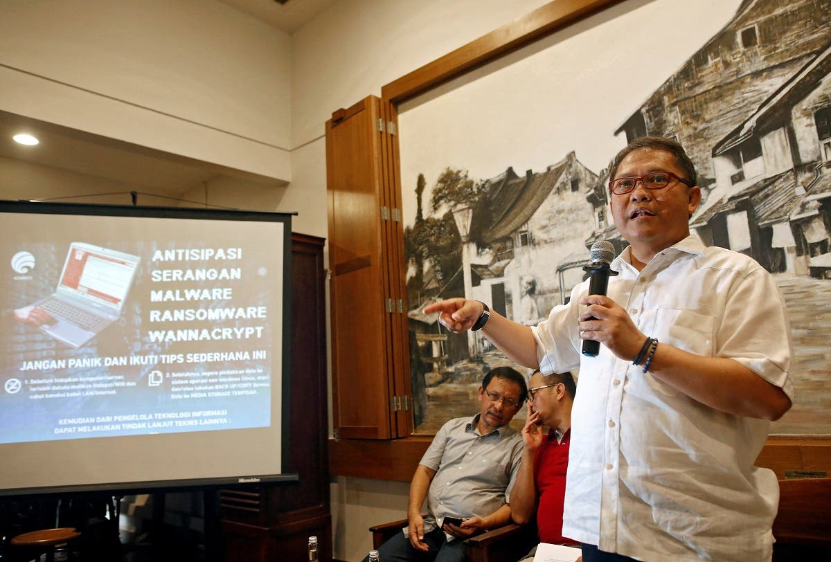Indonesia's Minister of Communications and Information, Rudiantara, speaks to journalists during a press conference about the recent cyber attack, at a cafe in Jakarta. (Reuters)