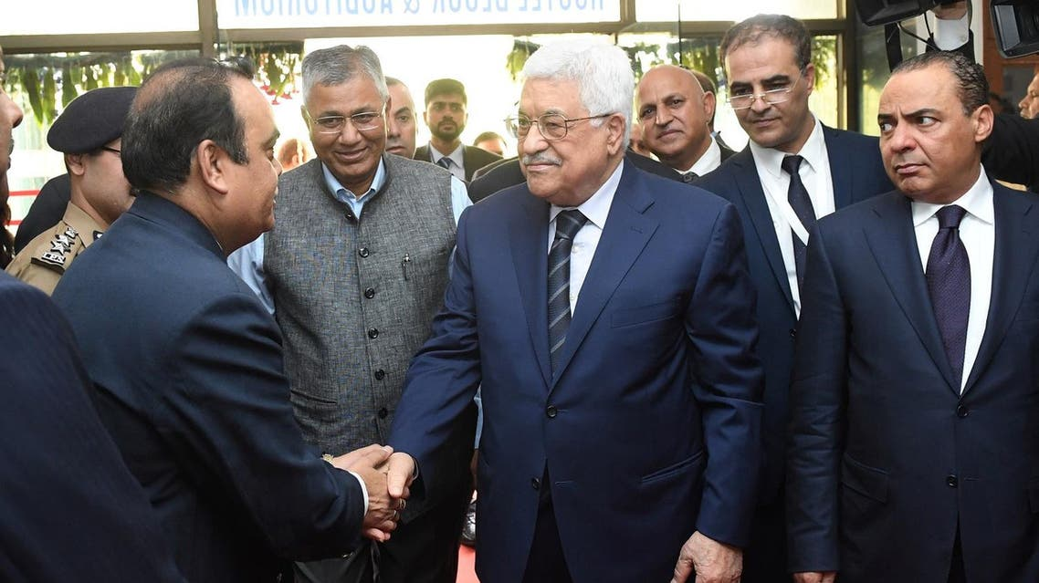 Palestinian President Mahmoud Abbas (R) is met by officials at the start of a visit to the Centre for Development of Advanced Computing in Noida, on the outskirts of the Indian capital New Delhi, on May 15, 2017. (AFP)