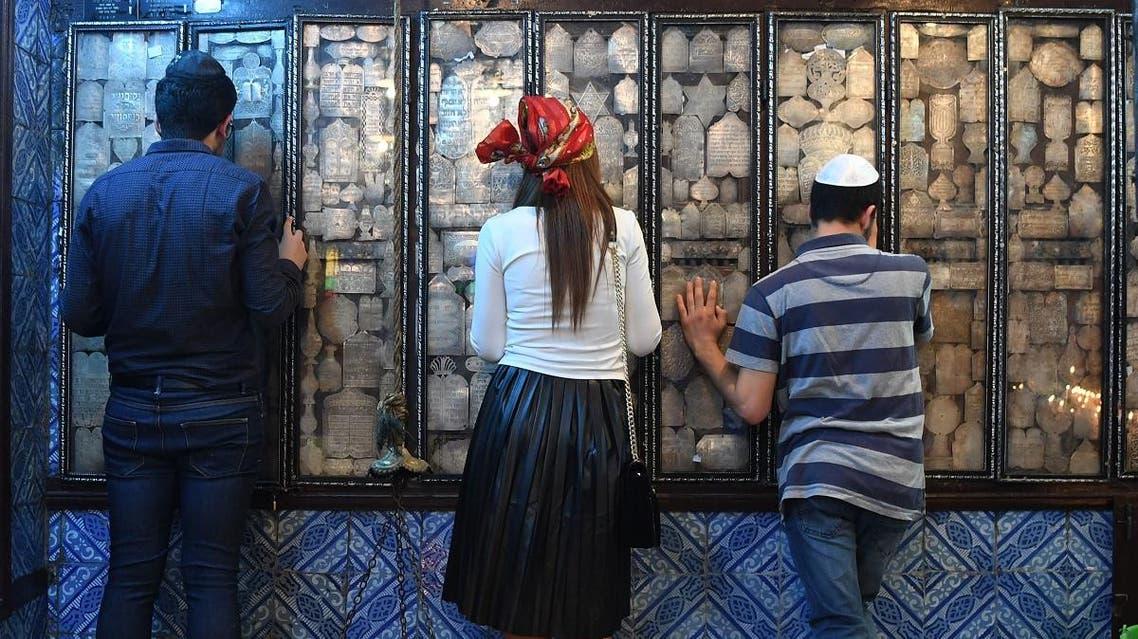 Jewish pilgrims pray at the Ghriba synagogue in the Tunisian resort island of Djerba. (AFP)